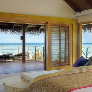 Constance Moofushi - Luxury Maldives Honeymoon Packages - Senior Water Villa bedroom view