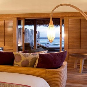 Constance Moofushi - Luxury Maldives Honeymoon Packages - Senior Water Villa bedroom1
