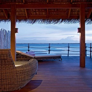 Constance Moofushi - Luxury Maldives Honeymoon Packages - Senior Water Villa deck at night