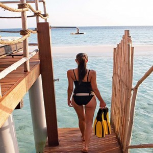 Constance Moofushi - Luxury Maldives Honeymoon Packages - Senior Water Villa step down to lagoon