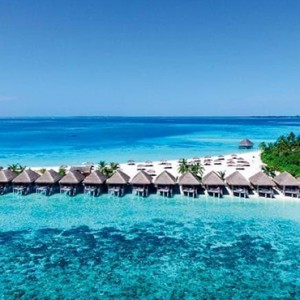 Constance Moofushi - Luxury Maldives Honeymoon Packages - Side View of water villas