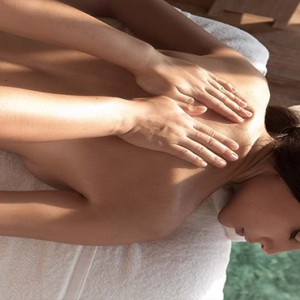 Constance Moofushi - Luxury Maldives Honeymoon Packages - Spa massage with glass floor view