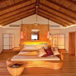 Constance Moofushi - Luxury Maldives Honeymoon Packages - Water Villa Bedroom