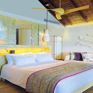 Constance Moofushi - Luxury Maldives Honeymoon Packages - Water Villa Bedroom overview