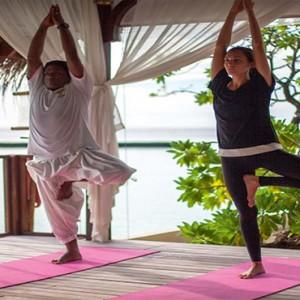 Constance Moofushi - Luxury Maldives Honeymoon Packages - Yoga