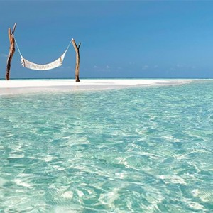 Constance Moofushi - Luxury Maldives Honeymoon Packages - hammock on the beach