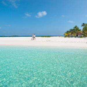Diamonds Athuruga - Luxury Maldives Honeymoon Packages - Romantic stroll on beach