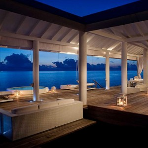 Diamonds Athuruga - Luxury Maldives Honeymoon Packages - Two Bedroom Water Villa deck at night