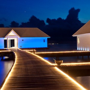 Diamonds Athuruga - Luxury Maldives Honeymoon Packages - Two Bedroom Water Villa exterior at night