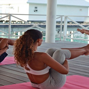 Diamonds Athuruga - Luxury Maldives Honeymoon Packages - Yoga1