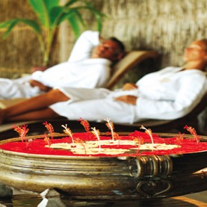 Diamonds Athuruga - Luxury Maldives Honeymoon Packages - couple relaxing spa
