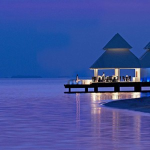 Diamonds Athuruga - Luxury Maldives Honeymoon Packages - over water restaurant