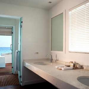 Diamonds Athuruga - Luxury Maldives Honeymoon Packages - overwater suites bathroom