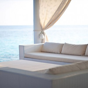 Diamonds Athuruga - Luxury Maldives Honeymoon Packages - relaxing seat on deck