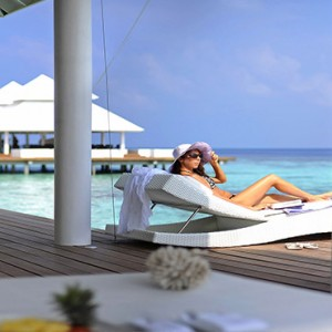Diamonds Athuruga - Luxury Maldives Honeymoon Packages - women relaxing on villa deck