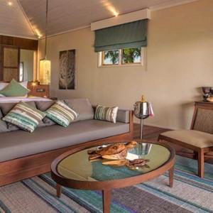 Hurawalhi Island - Luxury Maldives Honeymoon Packages - Beach Sunset Pool Villa interior bedroom