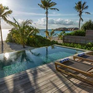 Hurawalhi Island - Luxury Maldives Honeymoon Packages - Beach Sunset Pool Villa ocean and pool view