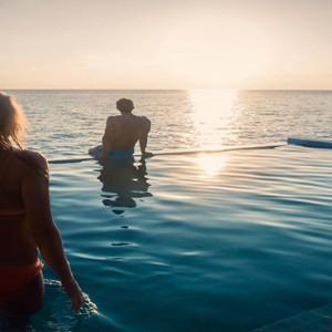 Hurawalhi Island - Luxury Maldives Honeymoon Packages - Couple in pool