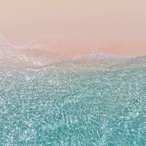 Hurawalhi Island - Luxury Maldives Honeymoon Packages - Couple on beach