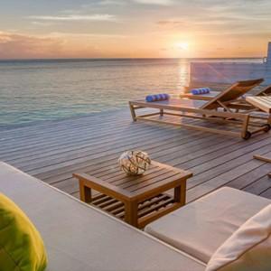 Hurawalhi Island - Luxury Maldives Honeymoon Packages - Ocean Villas deck at sunset
