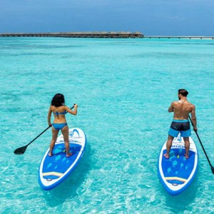 Hurawalhi Island - Luxury Maldives Honeymoon Packages - Paddleboarding