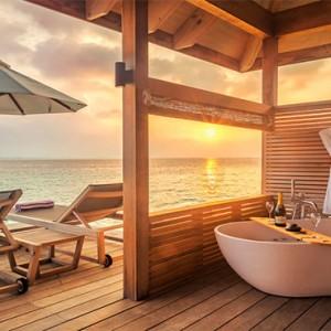 Hurawalhi Island - Luxury Maldives Honeymoon Packages - Romantic Ocean Villas bathtub and deck with view