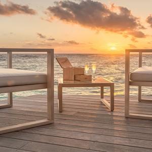 Hurawalhi Island - Luxury Maldives Honeymoon Packages - champagne pavillion at sunset