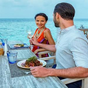 Hurawalhi Island - Luxury Maldives Honeymoon Packages - dining by sea