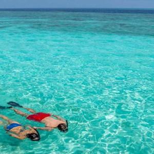 Hurawalhi Island - Luxury Maldives Honeymoon Packages - snorkeling