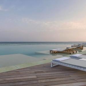 Hurawalhi Island - Luxury Maldives Honeymoon Packages - sun loungers by pool
