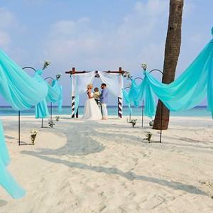 Hurawalhi Island - Luxury Maldives Honeymoon Packages - wedding on the beach
