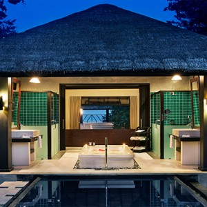 JA Manafaru - Luxury Maldives Honeymoon Packages - Beach Bungalows with Private Pools at night