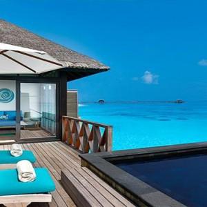 JA Manafaru - Luxury Maldives Honeymoon Packages - Sunrise water villas with infinity pools exterior 1