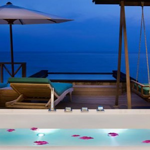 JA Manafaru - Luxury Maldives Honeymoon Packages - Sunset water villas with infinity pools bath view