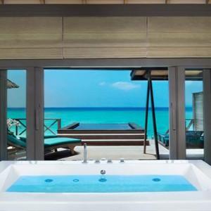 JA Manafaru - Luxury Maldives Honeymoon Packages - Sunset water villas with infinity pools bathroom