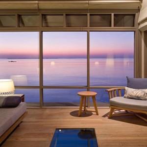 JA Manafaru - Luxury Maldives Honeymoon Packages - Sunset water villas with infinity pools living area