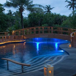 JA Manafaru - Luxury Maldives honeymoon packages - Andiamo Bistro and Pool outdoors at night