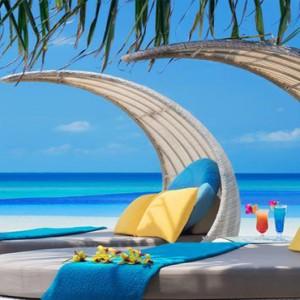 JA Manafaru - Luxury Maldives honeymoon packages - Infinity Bar and Pool seating area