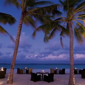 JA Manafaru - Luxury Maldives honeymoon packages - Ocean grill beach dining at night