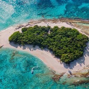 JA Manafaru - Luxury Maldives honeymoon packages - castaway island aerial view