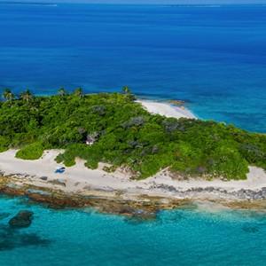 JA Manafaru - Luxury Maldives honeymoon packages - castaway island aerial view1
