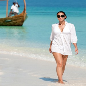 JA Manafaru - Luxury Maldives honeymoon packages - castaway island women on beach