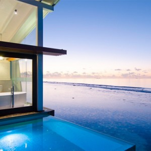 Kandolhu Maldives - Luxury Maldives Honeymoon Packages - Ocean Pool Villa at night