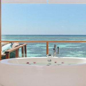 Kandolhu Maldives - Luxury Maldives Honeymoon Packages - Ocean Villa bathroom1