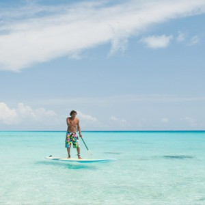 Kandolhu Maldives - Luxury Maldives Honeymoon Packages - Paddle boarding