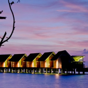 Kandolhu Maldives - Luxury Maldives Honeymoon Packages - overwater villas at night