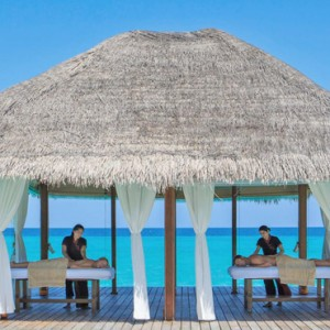 Kuramathi Maldives - Luxury Maldives Honeymoon Packages - couple spa massage over the lagoon