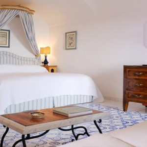Le Sirenuse - Luxury Italy Honeymoon Packages - Pool Terrace view bed