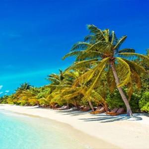 Lily Beach Resort and Spa at Huvahendhoo - Luxury Maldives Honeymoon Packages - Beach Villa beach