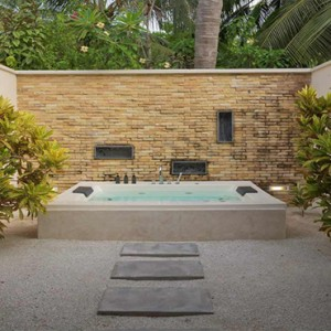 Lily Beach Resort and Spa at Huvahendhoo - Luxury Maldives Honeymoon Packages - Beach Villa jacuzzi bath tub